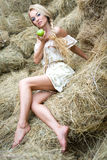 A girl on the straw royalty free stock photo