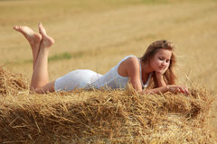 Girl on straw Royalty Free Stock Image
