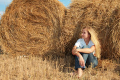 Girl at straw Stock Photo