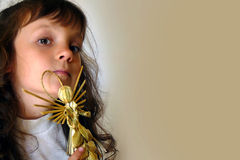The girl with a straw angel. The small little girl with an angel Royalty Free Stock Images