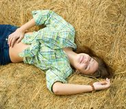 Girl on straw bale Royalty Free Stock Images