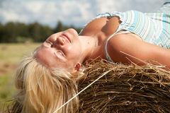 Girl on the straw bale Stock Photography