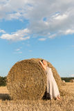 Girl and straw bales Royalty Free Stock Photography