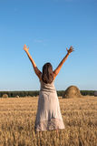 Girl and straw bales Stock Photography