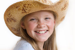 The girl in a straw hat. On a vacation in a summer sunny day carefree rejoices lives Royalty Free Stock Photos