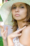 Girl in a straw hat Stock Photography