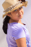 Girl and straw hat Royalty Free Stock Photo