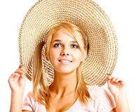Girl in straw hat Stock Images