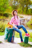 Girl in a straw hat and apples in autumn Royalty Free Stock Photo