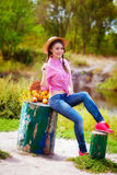 Girl in a straw hat and apples in autumn Stock Images