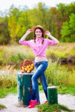 Girl in a straw hat and apples in autumn Stock Photo