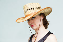 Girl in a straw hat Royalty Free Stock Image