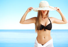Girl a straw hat (medium format image) Stock Photo