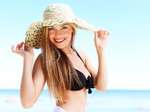 Girl a straw hat (medium format image) Royalty Free Stock Images
