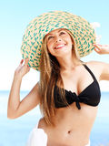 Girl a straw hat (medium format image) royalty free stock photography