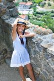 Girl in straw hat near ancient wall in Eus, France. Girl in straw hat near ancient wall in Eus stock photography