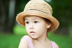 Girl in a straw hat in the park Stock Images