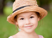 Girl in a straw hat in the park Royalty Free Stock Photography