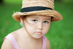 Girl in a straw hat in the park Royalty Free Stock Photos