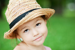 Girl in a straw hat in the park Royalty Free Stock Image
