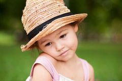Girl in a straw hat in the park Royalty Free Stock Images