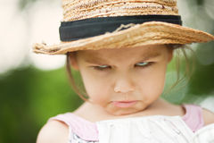 Girl in a straw hat in the park Royalty Free Stock Photo