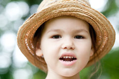 Girl in a straw hat in the park Stock Photo