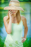 Girl in straw hat with phone Royalty Free Stock Images