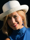 Girl with straw hat. A smiling girl with red lipstick and white straw hat Royalty Free Stock Photo