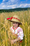 Girl in a straw hat Stock Images