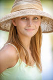 Girl in straw hat Stock Photography