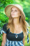 Girl in straw hat Stock Photos