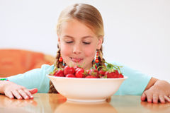 Girl with strawberries Stock Photo