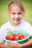 Girl with strawberries Royalty Free Stock Photos