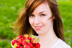 Girl and strawberries Stock Images