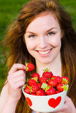 Girl and strawberries Royalty Free Stock Images