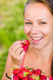 Girl and strawberries Royalty Free Stock Photo