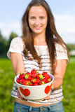 Girl and strawberries Royalty Free Stock Image