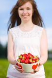 Girl and strawberries Royalty Free Stock Photos