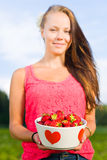 Girl and strawberries Stock Photography