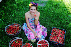Girl with strawberries. The l girl in the garden with strawberries stock photography