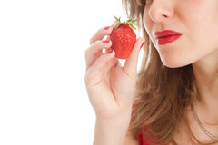 Girl with a strawberry. Beautiful woman with a strawberry Royalty Free Stock Photos