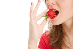 Girl with a strawberry. Beautiful woman with a strawberry Royalty Free Stock Photo