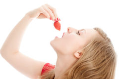 Girl with a strawberry. Stock Image