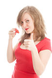 Girl with a strawberry. Beautiful woman with a strawberry Stock Image