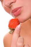 Girl with a strawberry Stock Photography