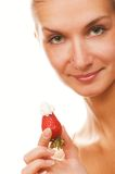 Girl with a strawberry Stock Image