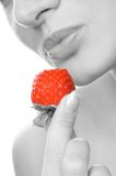 Girl with a strawberry Stock Photos