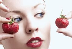 Girl and strawberry royalty free stock photo