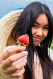 A girl with strawberry. Stock Images